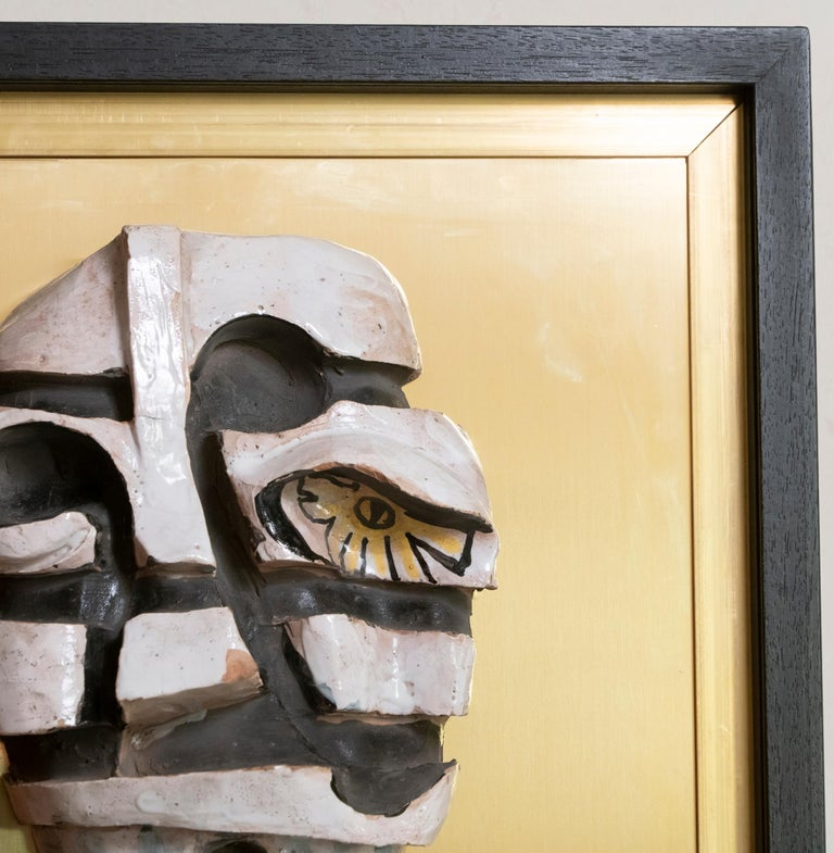 Cubism style figurative glazed terracotta wall art on natural brass structure and framed in black wood, unknown artist, Italy, circa 1970s.