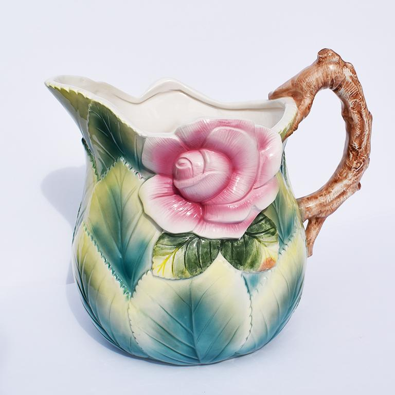 Lovely ceramic pitcher with floral garden motif. 