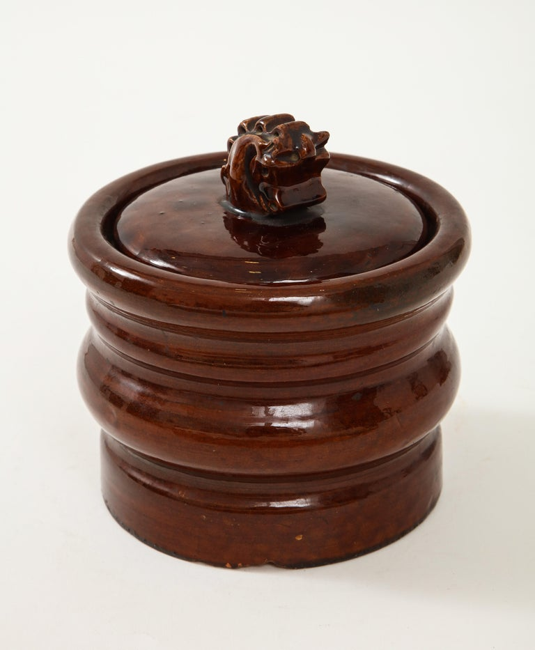 Signed vintage brown ceramicHermès tabacco jar with a depiction of a horse bust for lid handle.