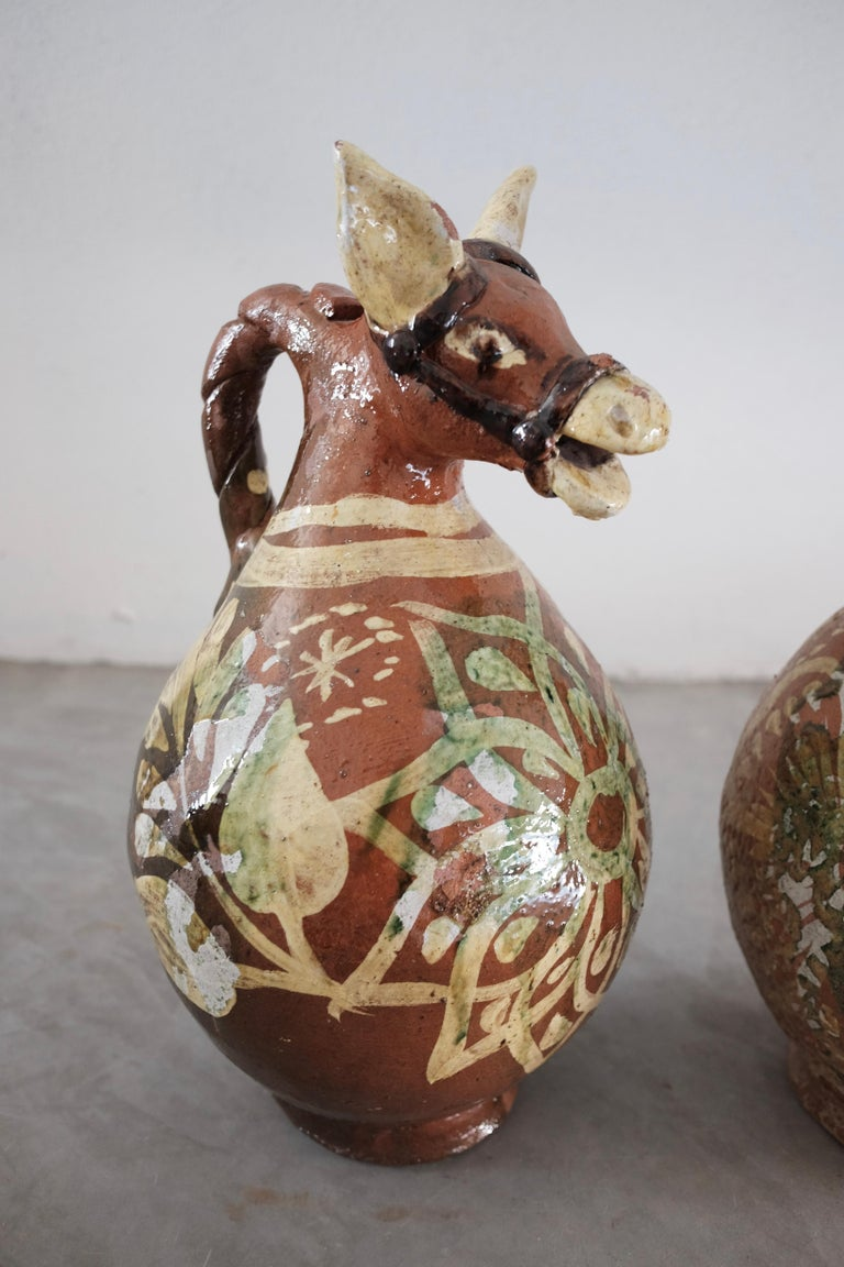 Pair of ceramic horse pitchers once used to serve pulque (fermented agave beverage). Glazed and painted.