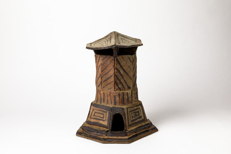Architectural stoneware ceramic sculpture.  Realised by Jacques Laroussinie, French artist.  Brown and black ceramic colors,  circa 1980.  Realised in la Borne.  Signed on the base by a house drawing.  Dimensions : 32 x 22 x 22cm.