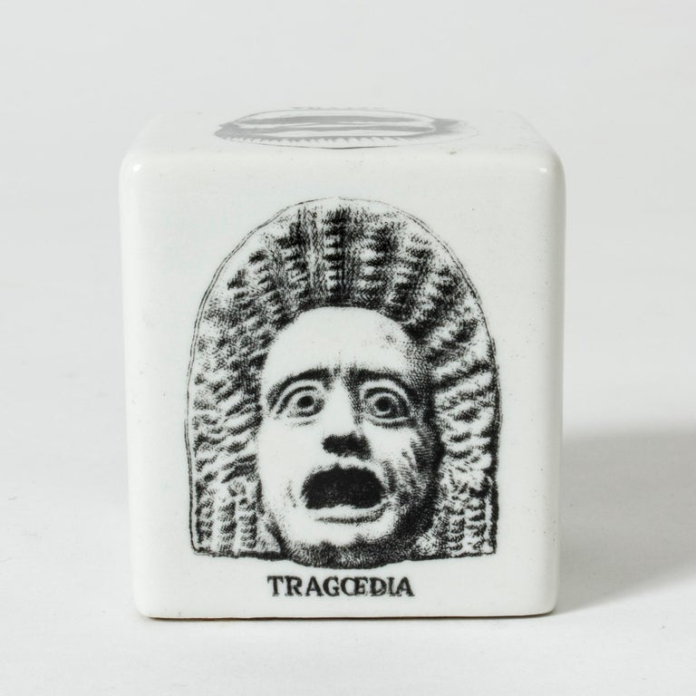 Expressive ceramic paper weight by Piero Fornasetti. Decor on each side of theatre masks representing different genres.