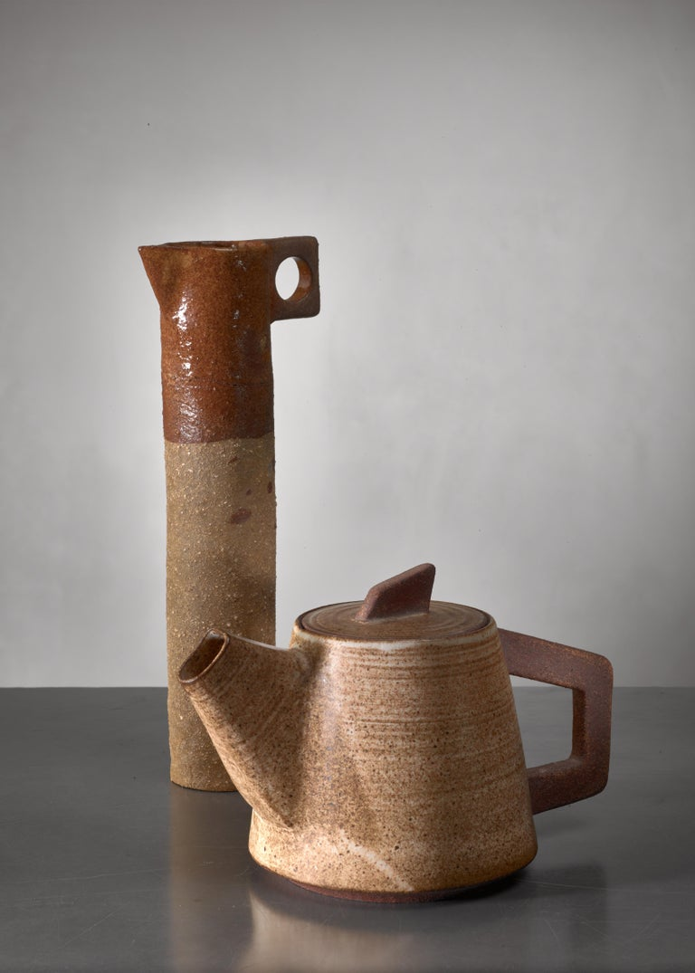 A thin ceramic pitcher and pot from France. A beautiful decorative set.   The measurements stated are of the pitcher.