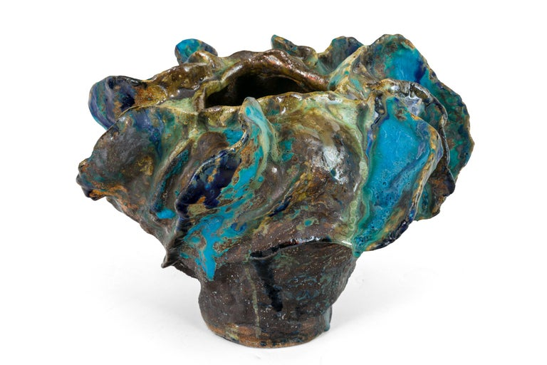 We recently acquired several pieces by contemporary Danish ceramicist Henrik Folsgaard. His work is reminiscent of American ceramic artist George Ohr whose work was considered an early example of abstract expressionist ceramics.