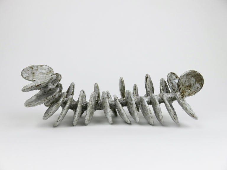 Ceramic Sculpture, Reclining Skeletal Spine in Mottled White and Brown For Sale 4