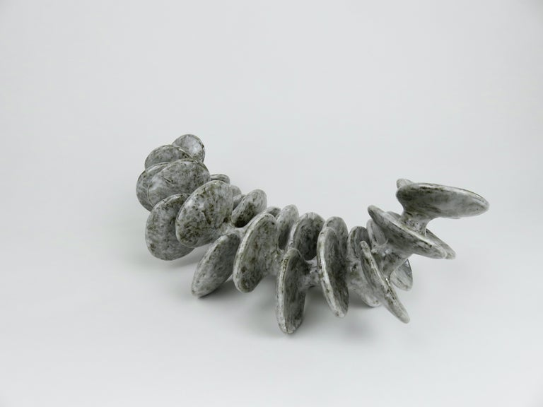 American Ceramic Sculpture, Reclining Skeletal Spine in Mottled White and Brown For Sale