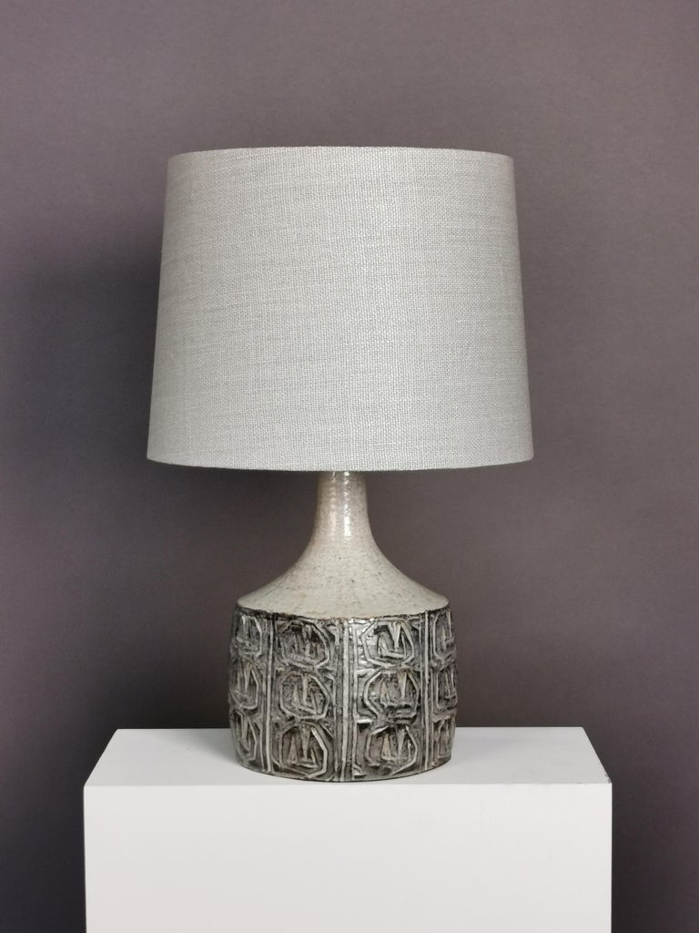 Light grey glazed stoneware table lamp by Danish ceramic artist Jette Hellerøe for Axella.