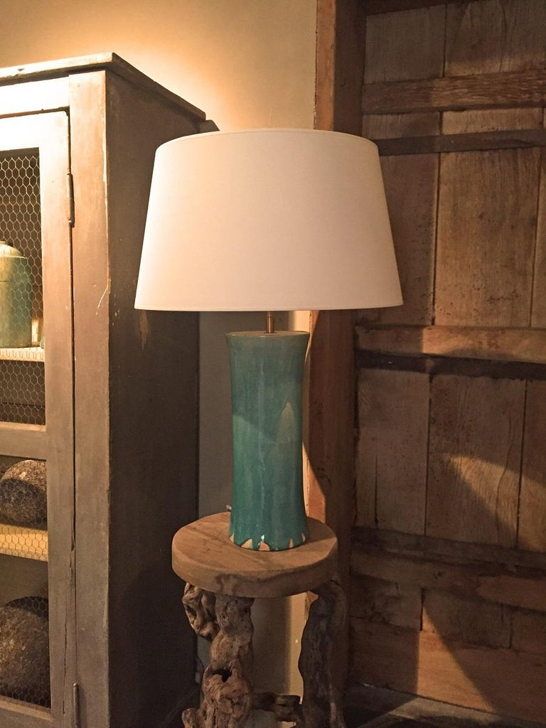 Newly made table lamp from a contemporary Asian bleu and crackled glazed vase. This piece was made in a classic Chinese style by master craftsmen who are upholding a thousand year old tradition of pottery which they are still perfecting today.