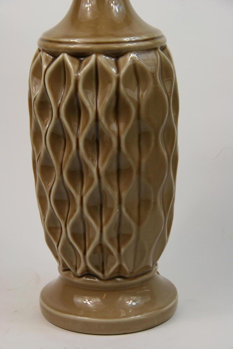 2-297 ceramic geometric pattern with wood stem. Takes one 100 watt max Edison based bulb Original wiring in working condition 24