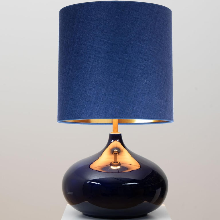 Ceramic table lamp, Denmark, 1960s. A sculptural high-end piece made of handmade ceramic in rich glazed dark blue tones. With a new custom made blue silk lamp shade with warm gold inner, shade by René Houben.