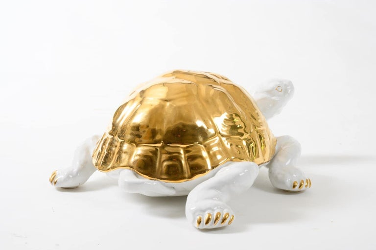 """Cute, chic white ceramic tortoise with gold detailing by Ronzan. Signed to the underside """"Ronzan"""" """" Made in Italy"""" & the number 1640, Italy, circa 1970."""