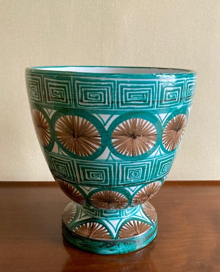 Decorative ceramic vase by Robert Picault.  Geometric pattern in white, green and brown glazes. Signed under the base