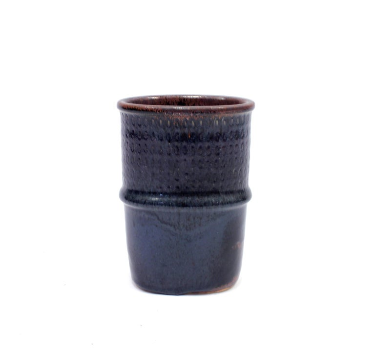 Blue/purple vase by renowned Swedish ceramicist Stig Lindberg for his long time collaborator Gustavsberg. Inside with brown/black finish. Made in the 1950s. Very good condition with light ware consistent with age and use. Hand signed on the bottom.