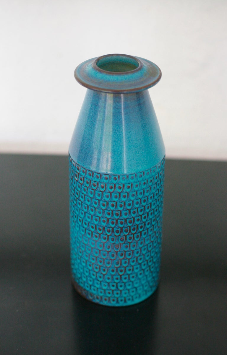 Great stoneware vase by Stig Lindberg. Beautiful blue glaze with a graphic fish scale pattern. Fully signed indicating it was made in 1967.