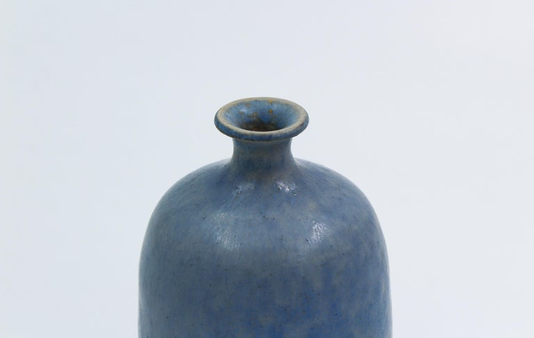 A blue vase made by Swedish potter Svan Hansson, manufactured in Höganäs Sweden. Nice color to the glaze and a round shape makes this vase very decorative.