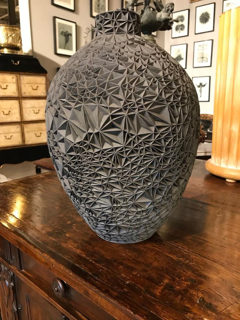 This wonderful piece combines the contemporary modern with the Italian Renaissance. Based on the 15th century painting, 'Primavera' by Sandro Botticelli, this black stoneware vessel has a carved, faceted exterior. A true work of art, more a piece of