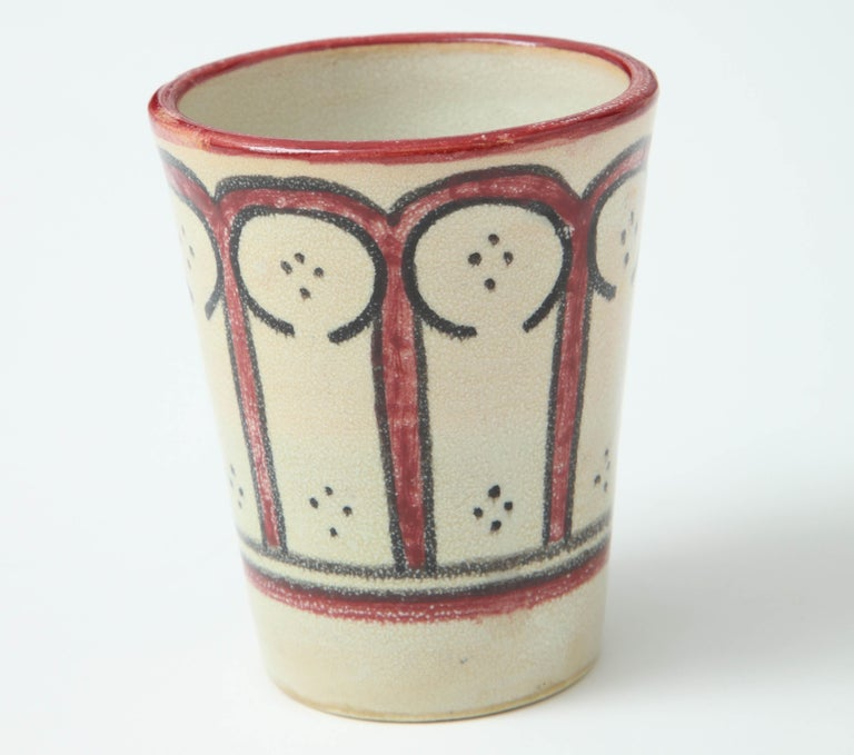Ceramic vessel from Morocco, red, black and cream. Handcrafted pottery by a local artist in Rabat.