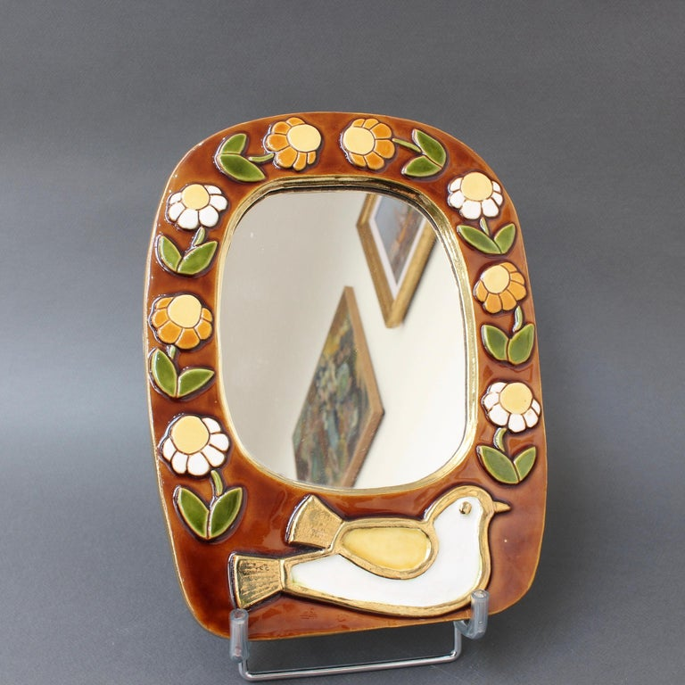 French Ceramic Wall Mirror with Flower Motif and Stylised Bird by Mithé Espelt, c. 1960 For Sale