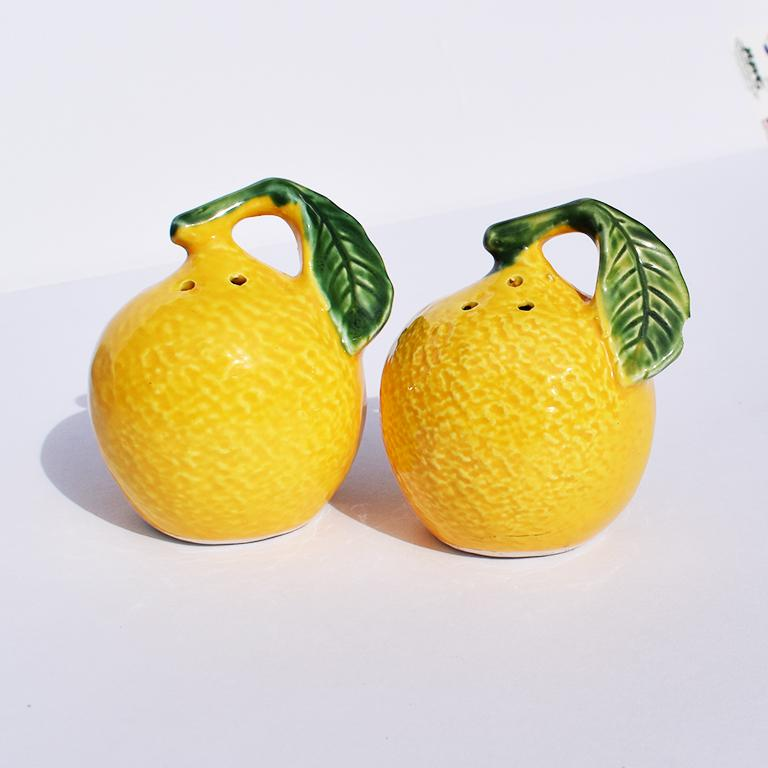 Pair of yellow lemon salt and pepper shakers. Lovely round fruit shakers in ceramic. Bottom signed