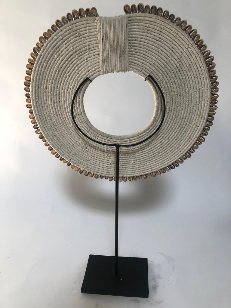 Circular ceremonial shell necklace from Asia.