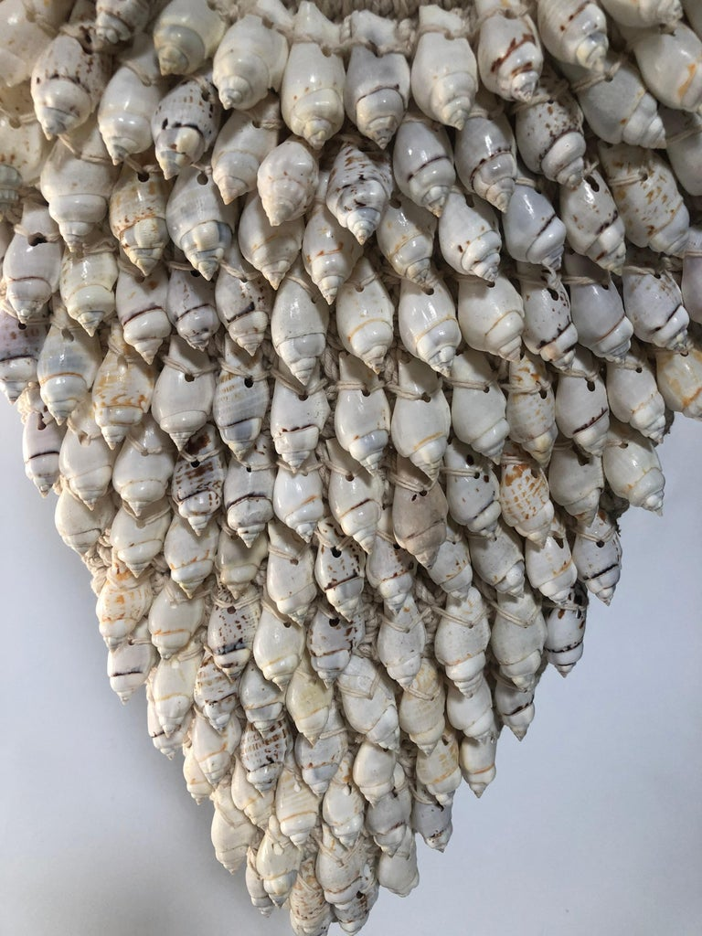 Asian Ceremonial Shell Necklace on Stand For Sale