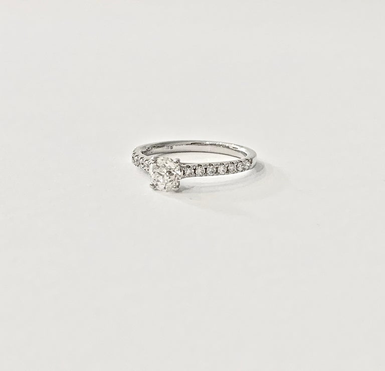 This beautiful 0.56ct Old Cut* diamond is set in a diamond band which gives an amazing play of fire and sparkle to the ring.  The diamond is Certified by WGI (London) as being G in colour and SI1 clarity, the stone measures 4.96-5.21 x 3.47 and has