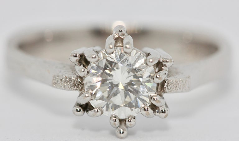 An almost perfect Diamond Solitaire, 18 Karat white Gold Ring.  1.01 Carat  Flawless Top Wesselton  Cut: Very Good