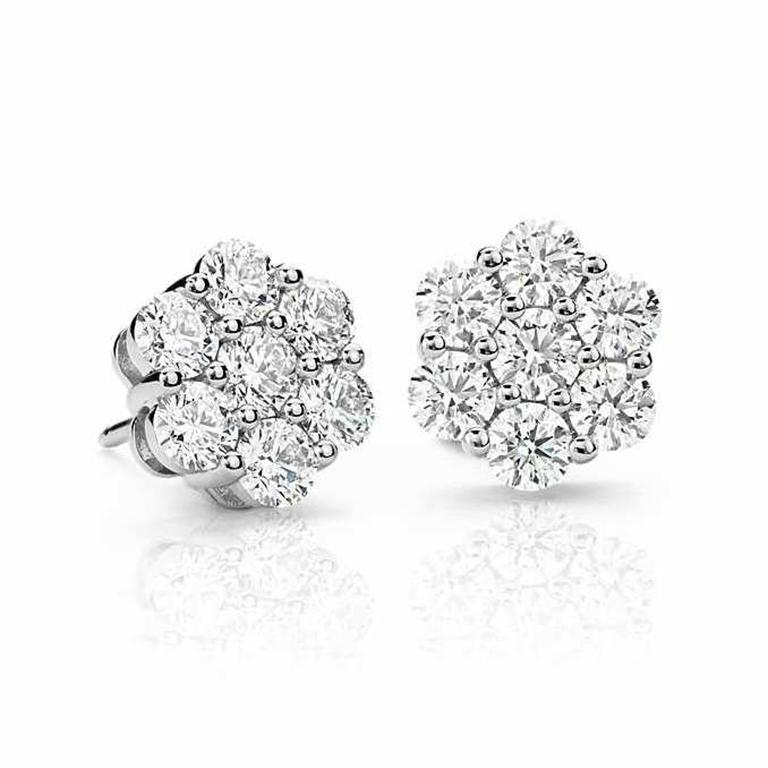 Intricate 1.00 Carat Round Diamond Flower Cluster Stud Earrings 8mm in 14K White Gold. Certified by IGI Laboratory in New York, with full diamond jewelry grading report.  1.00 Carats of Brilliant Round White VS-SI Diamonds, and 2.50 grams of 14K