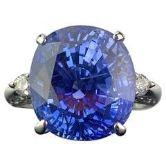 Certified 12.57 Carat Oval Ceylon Blue Sapphire Three-Stone Engagement Ring
