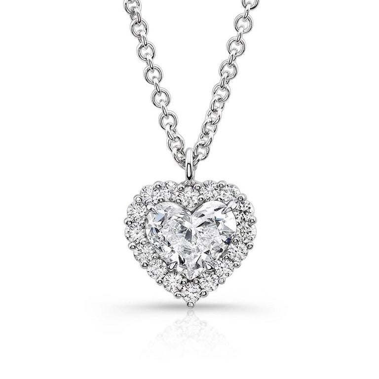 Lovely 1.21 Carat Heart Cut Diamond Solitaire Halo Pendant Necklace in 14K White Gold. Certified by GIA Laboratory in New York, with a full diamond grading report certificate.  GIA 0.61 carat Heart SI1 G Diamond center with 0.60 Carats of Round