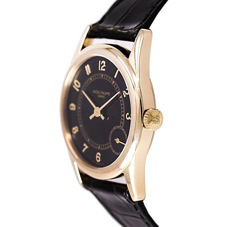Contemporary Certified 1995 Patek Philippe Calatrava 5000J Black Dial For Sale
