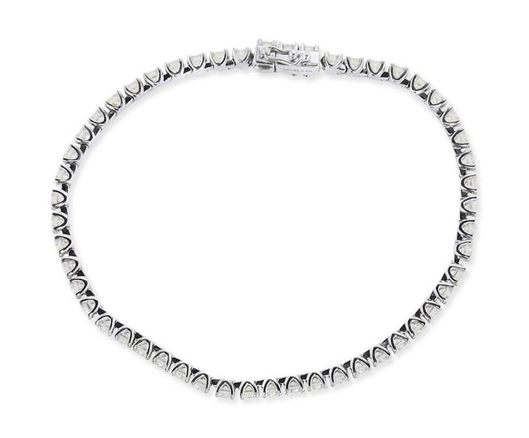 Classic 2.00 Carat Round Diamond Tennis Bracelet 2mm in 14K White Gold. Certified by IGI Lab in New York, with full diamond jewelry grading report.  2.00 Carats of Brilliant Round White VS-SI Diamonds,  and 6.00 grams of 14K White Gold.  This is a