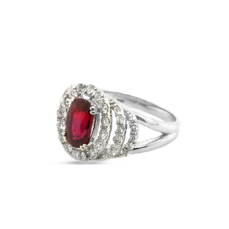 A 2.03 carat CGL Certified No Heat Ruby is accented with 0.74 carat of white round brilliant diamond. The image of the certificate can be seen along with the images of the ring. The details of the ring are mentioned below: Color: F Clarity: Vs Ring