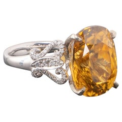 Certified 20.38 Carat Natural Yellow Zircon and Diamond Cocktail Ring