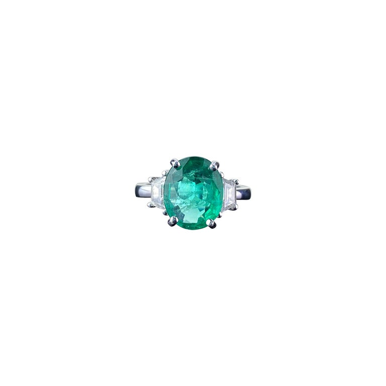 Certified 2.56 Carat Oval Shape Emerald and Diamond Three-Stone Engagement Ring For Sale