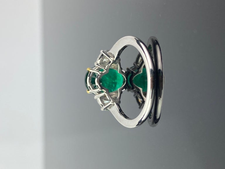 Modern Certified 2.68 Carat Oval Cut Emerald and Diamond Three-Stone Engagement Ring For Sale