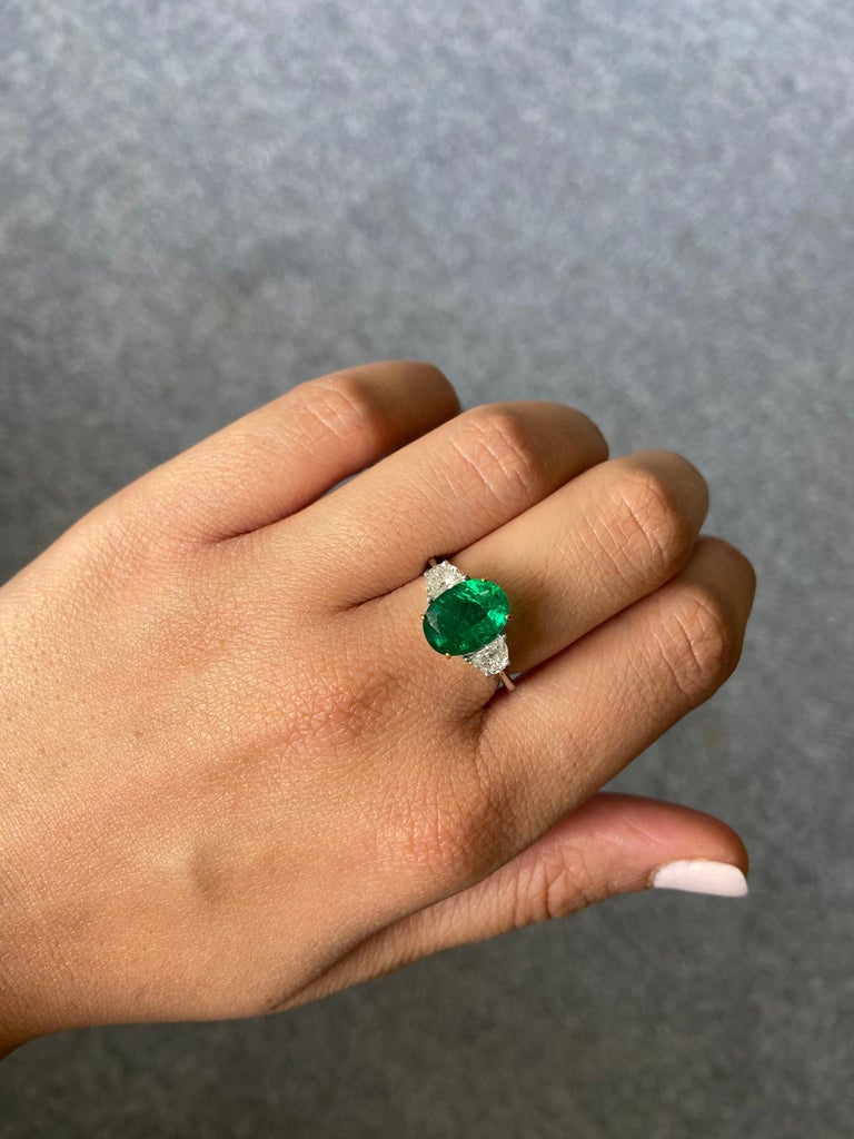 Women's Certified 2.68 Carat Oval Cut Emerald and Diamond Three-Stone Engagement Ring For Sale