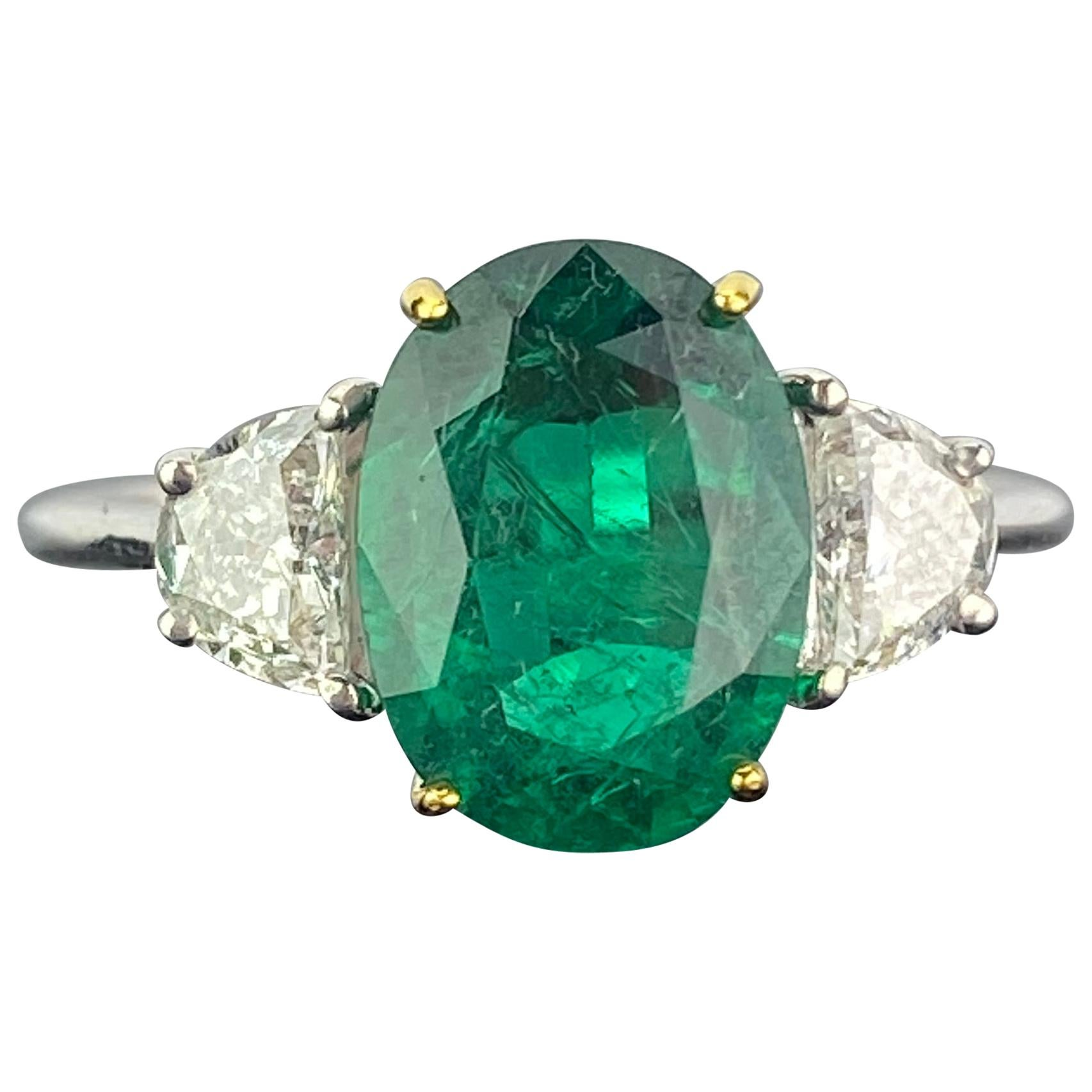 Certified 2.68 Carat Oval Cut Emerald and Diamond Three-Stone Engagement Ring
