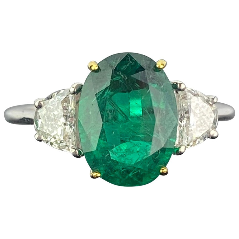 Certified 2.68 Carat Oval Cut Emerald and Diamond Three-Stone Engagement Ring For Sale