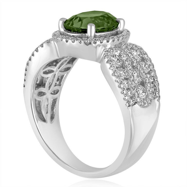 Stunningly Beautiful Green Sapphire Ring The ring is 18K White Gold There are 1.04 Carats in White Diamonds F/G VS/SI The center stone is a Oval Green Sapphire 3.08 Carats The stone is Certified by LAPIS, HEATED. The ring is a size 7, sizable. The