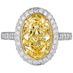 Certified 3.17 Carat Fancy Yellow Oval Diamond Engagement Ring in Platinum