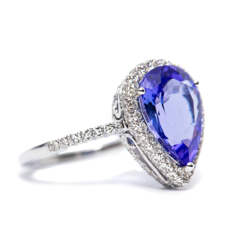 Modern 3.26 CT Pear Tanzanite Certified 0.75 Carat Diamond 18 KT Gold Engagement Ring For Sale
