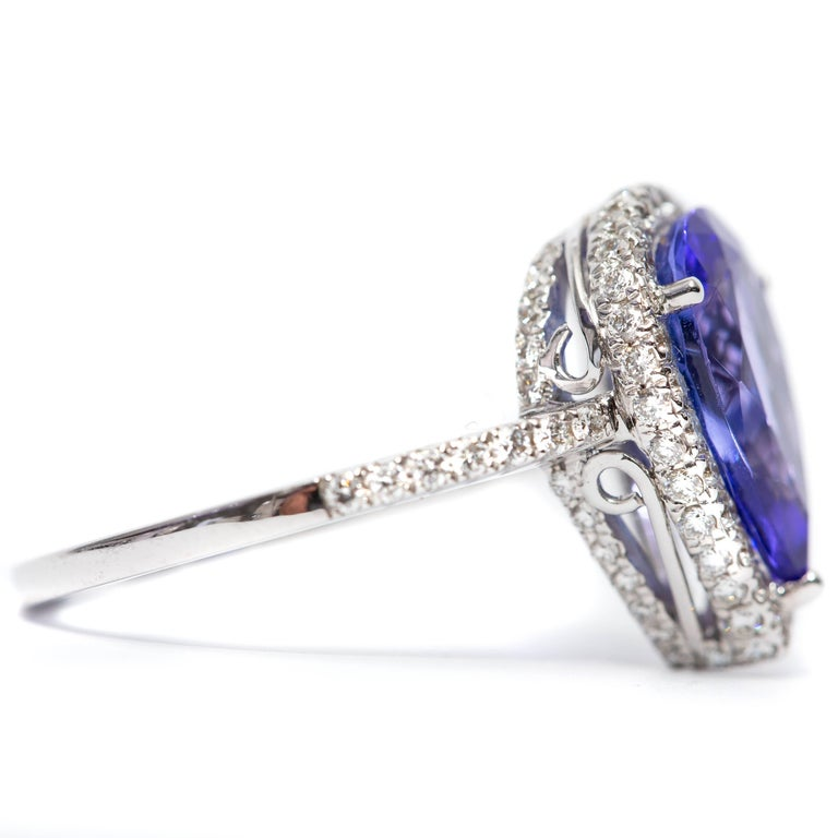 Women's 3.26 CT Pear Tanzanite Certified 0.75 Carat Diamond 18 KT Gold Engagement Ring For Sale