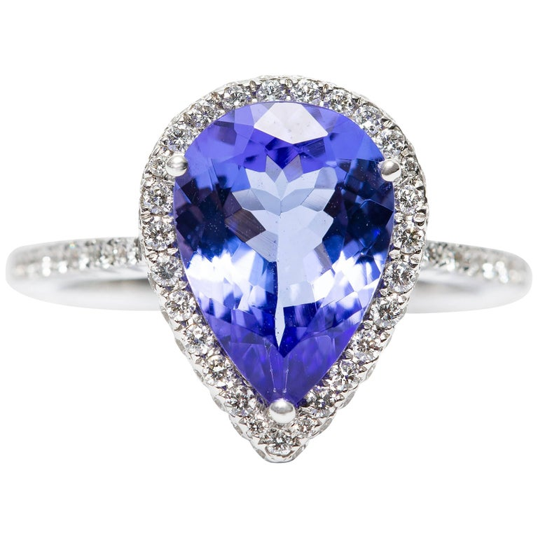 3.26 CT Pear Tanzanite Certified 0.75 Carat Diamond 18 KT Gold Engagement Ring For Sale