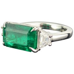 Certified 3.42 Carat Emerald and Diamond Three-Stone Engagement Ring