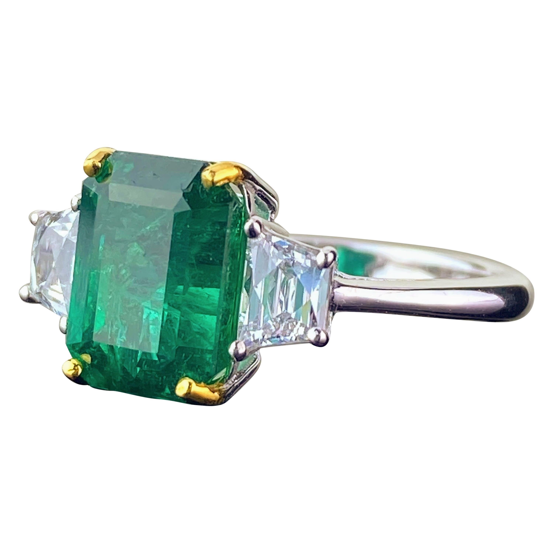 Certified 3.82 Carat Emerald and Diamond Three-Stone Engagement Ring