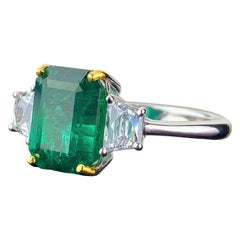 Certified 3.82 Carat Emerald and Diamond Three-Stone Engagement Ring