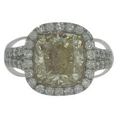 Certified 4 Carat Fancy Yellow Diamond and White Diamond Halo 18 Karat Ring