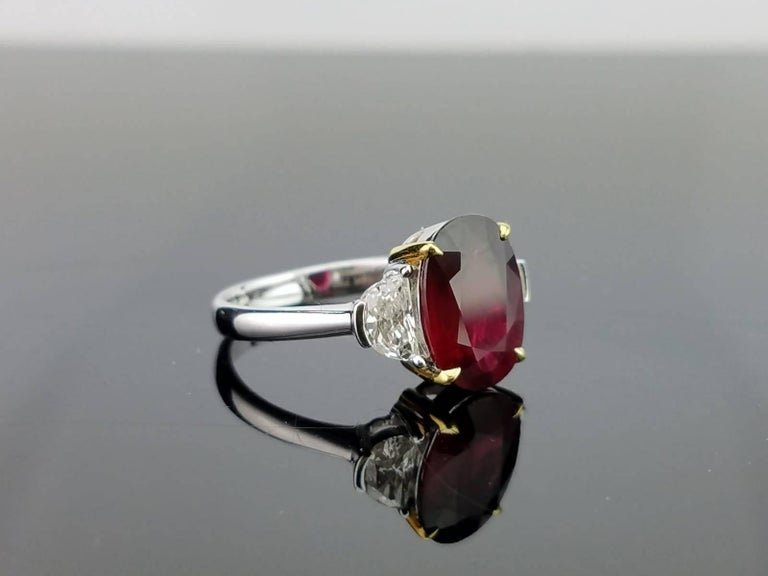 Oval Cut Certified 4.02 Carat No Heat Mozambique Ruby and Diamond Three-Stone Ring For Sale