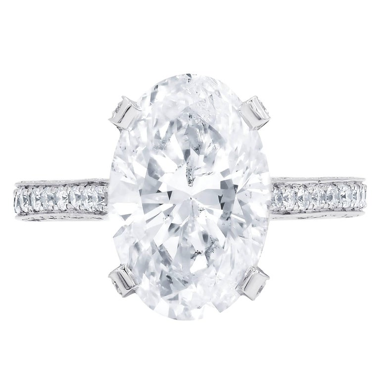 Certified 4.08 Carat Oval Cut E-SI2 Diamond Ring For Sale